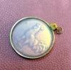 Gümüş Çerçevede gizli figürlü kolye ucu